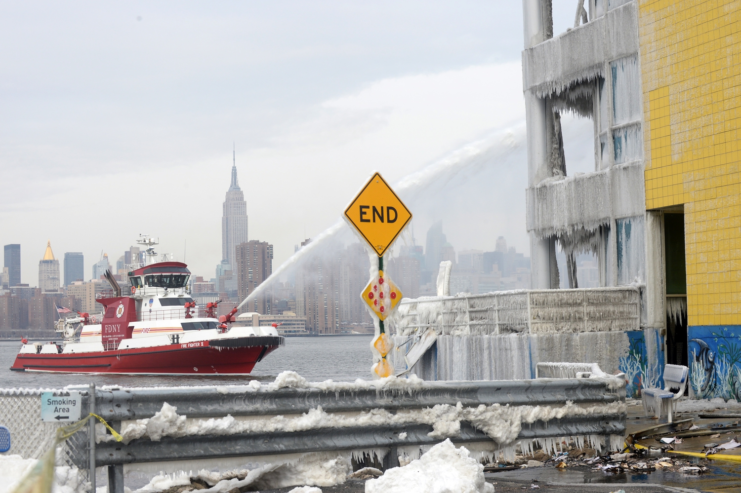 Firefighters continued pouring water on the remains of a 7-alarm fire in a warehouse on the Williamsburg waterfront