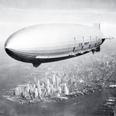 NH 43901 | NH 43901:  USS Macon (ZRS-5).  Flying over New York Harbor, circa Summer 1933. The southern end of Manhattan Island is visible in the lower left center.  Naval History and Heritage Command.  (2015/12/29).