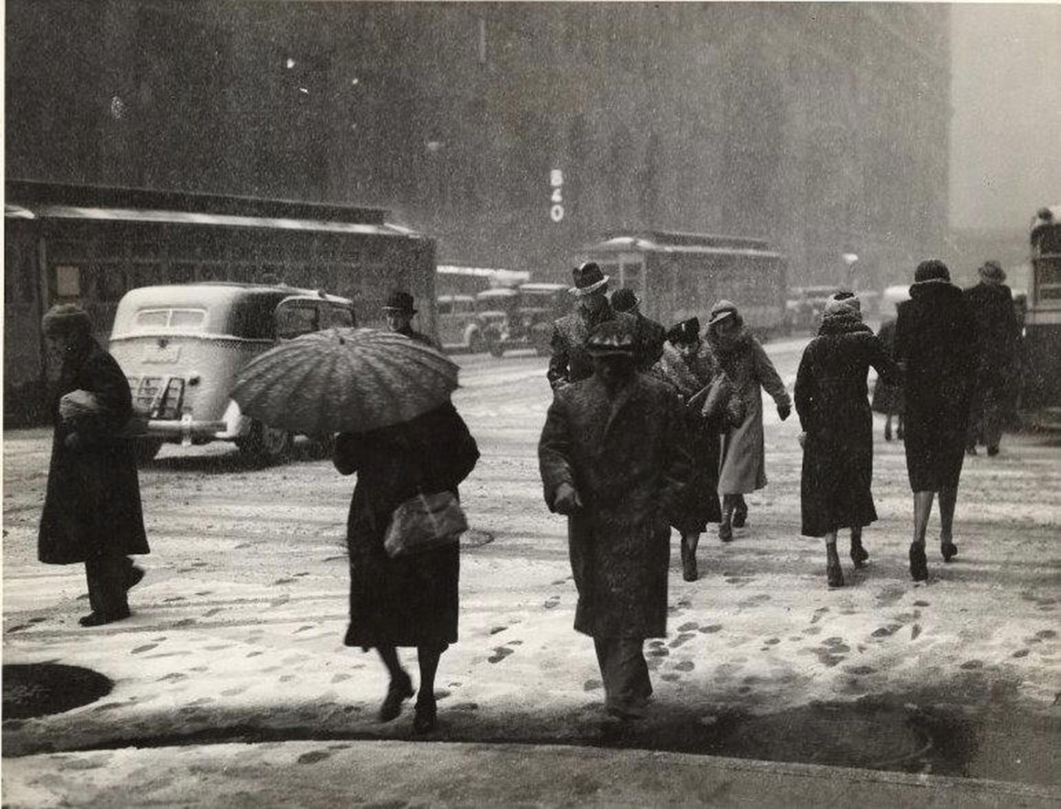1935 snowstorm effects on midtown Manhattan. Life goes on.
