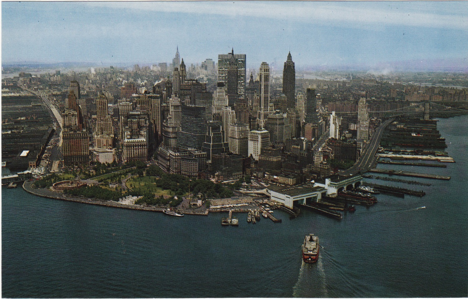 The Staten Island Ferry is arriving as Manhattan's classic skyline is seen from the south c 1963