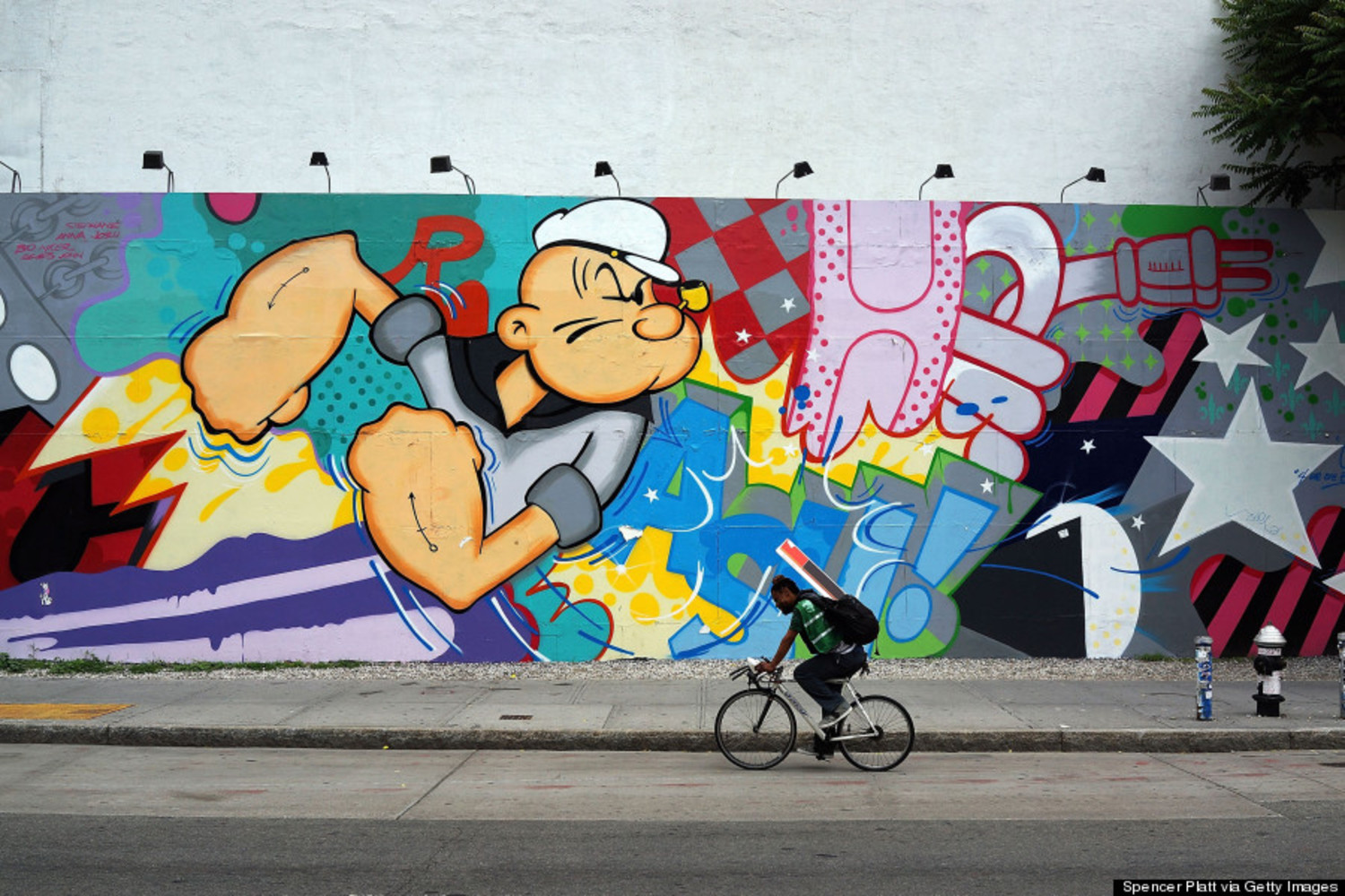A work of street art on the famed Houston Street wall by artist John Matos on June 6, 2013 in New York City.