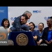 Doctor cured of Ebola, hugs NYC Mayor de Blasio