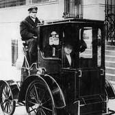 Woman passenger in a 1910 taxi cab, New York, USA