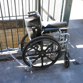 Wheelchair chained to NYC Subway stairs