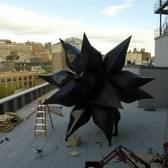 Installing Frank Stella: A Retrospective—Wooden Star I (2014) and Black Star (2014)