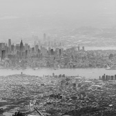 Manhattan Haze | Panorama taken from a flight out of Newark on a hazy day.  Canon 6D with a Canon 70-200mm f/2.8L (mark 1, non-IS). Stitched together with Microsoft ICE.  The original color image had a heavy, almost monochrome, blue cast.  Do you think I should have left the color in?