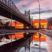 Sunrise over the Ed Koch Queensboro Bridge. Photographed from the Manhattan side on Dec 24, 2017. Manhattan, New York City