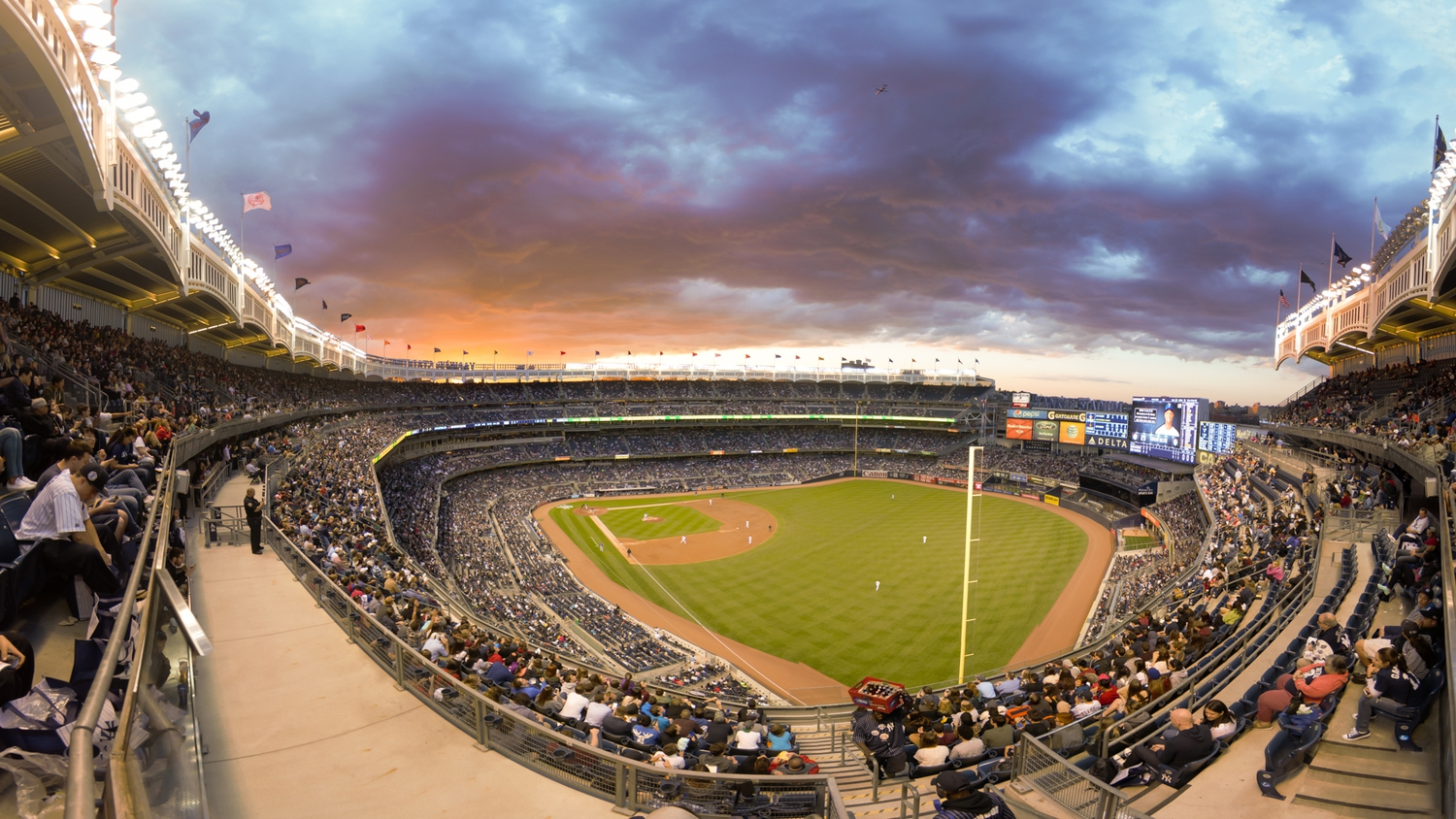 Yankee Stadium | An amazing sunset at Yankee Stadium while watching the Yankees play the Rangers.  Notice the plane in the shot, climbing out of takeoff from LaGuardia.
