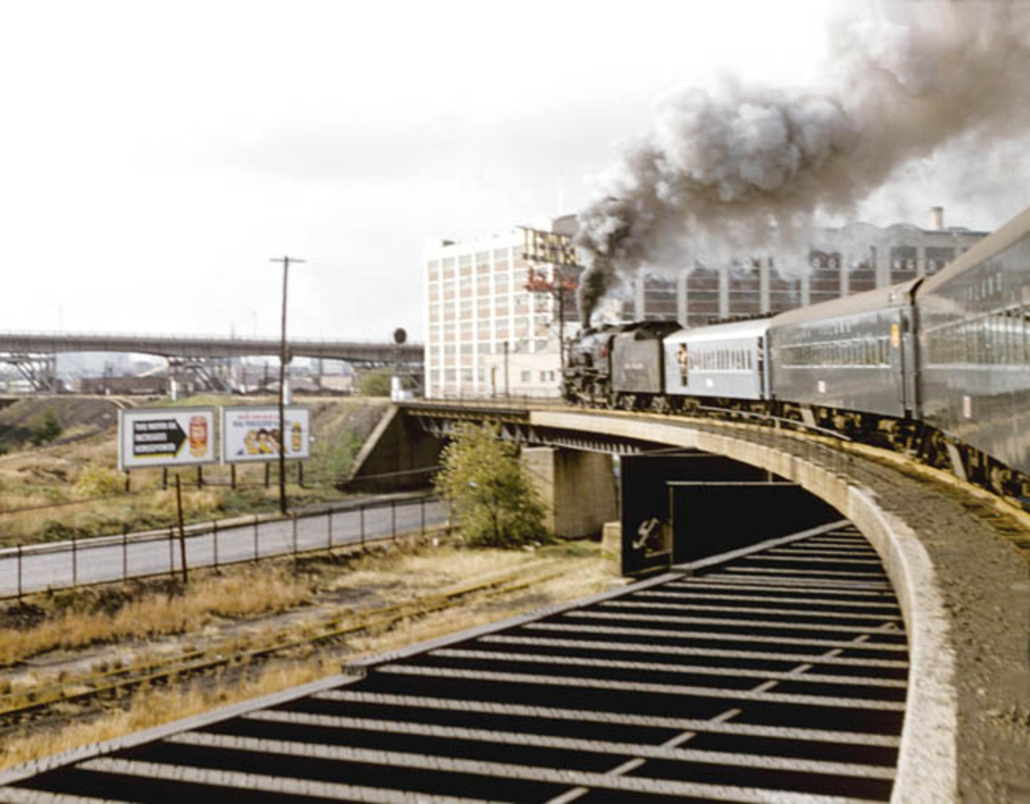Final stream passenger train on Long Island – Photo by Art Huneke – view is looking southeast, Skillman avenue is in the foreground.