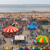 Summer fun in Luna Park, and a view of the beach and boardwalk in Coney Island, New York City