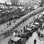 "Dec. 8, 1929: A centipede-like creation comprising several balloons during the annual parade put on by ""R.H. Macy & Co."" was set to fly into the sky at the parade's conclusion. The balloon animal was designed by Tony Sarg, a puppeteer whose name was associated with the parade in the early days — ""designed grotesque balloons in annual Macy parade,"" his obituary read."