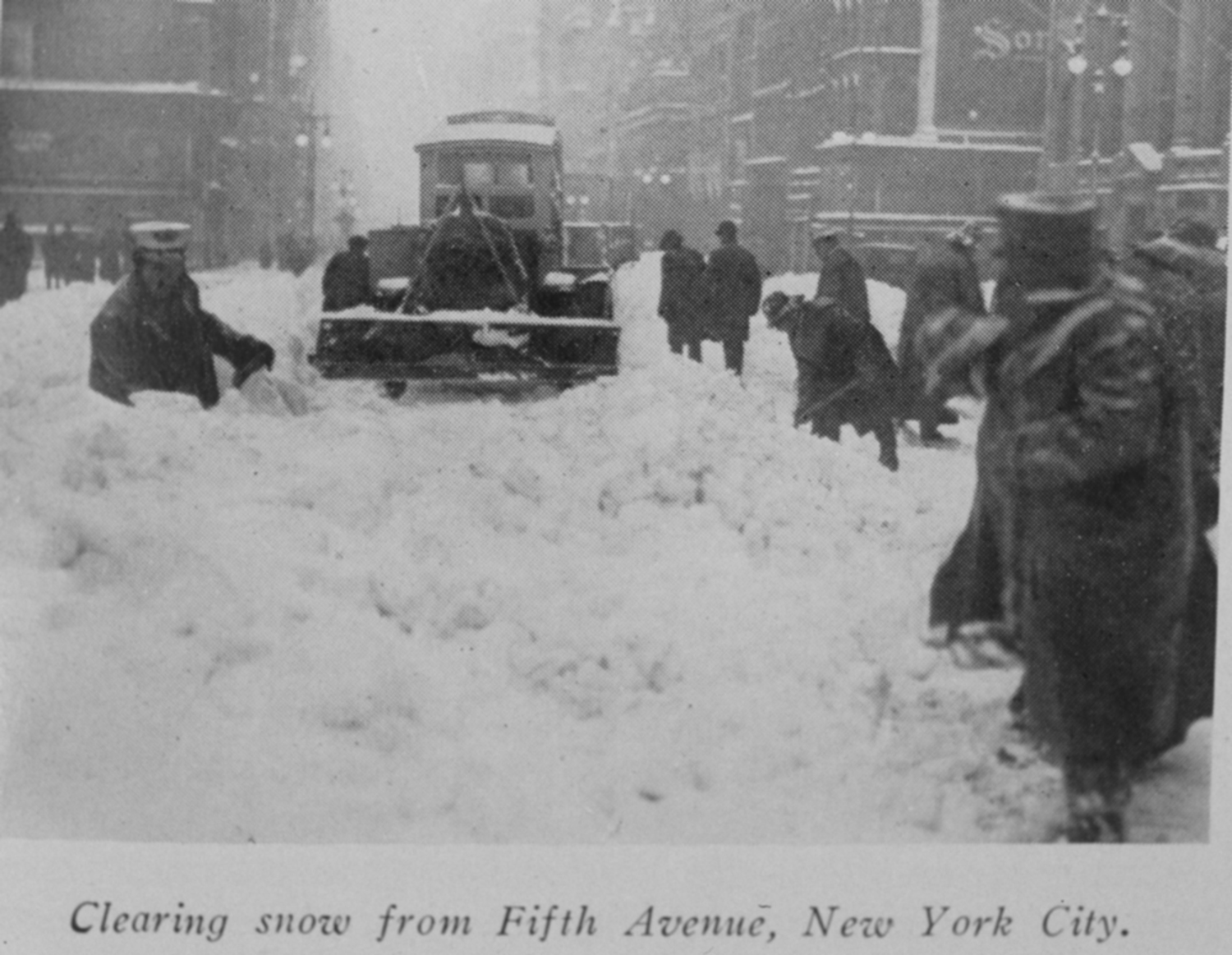 Snow shovelers clearing snow in New York City after a blizzard in 1926.
