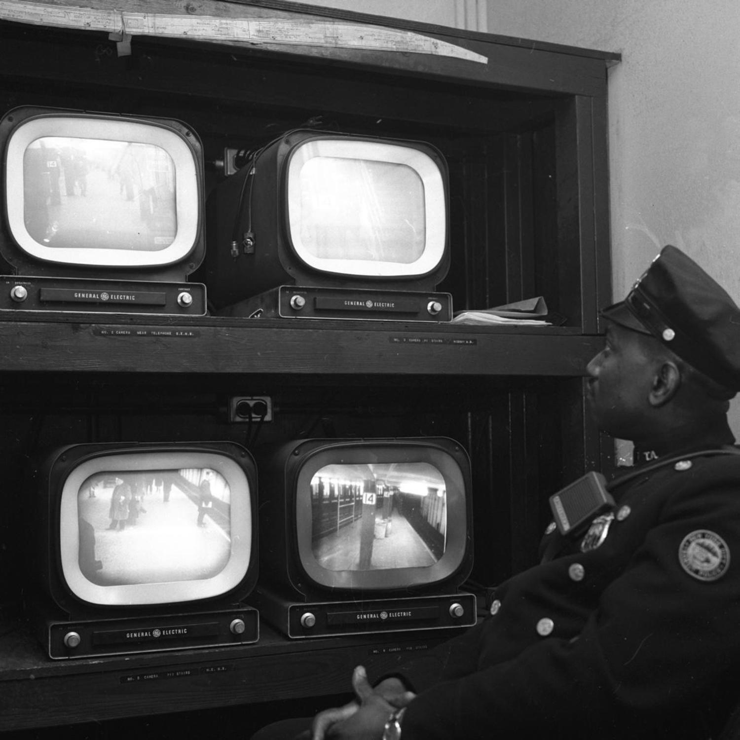 1960's: Transit Authority Patrolman Harold Reed has his eyes glued on TV monitors that provide different views of the 14th St. subway station in order to alert police of problem areas and deter crime.