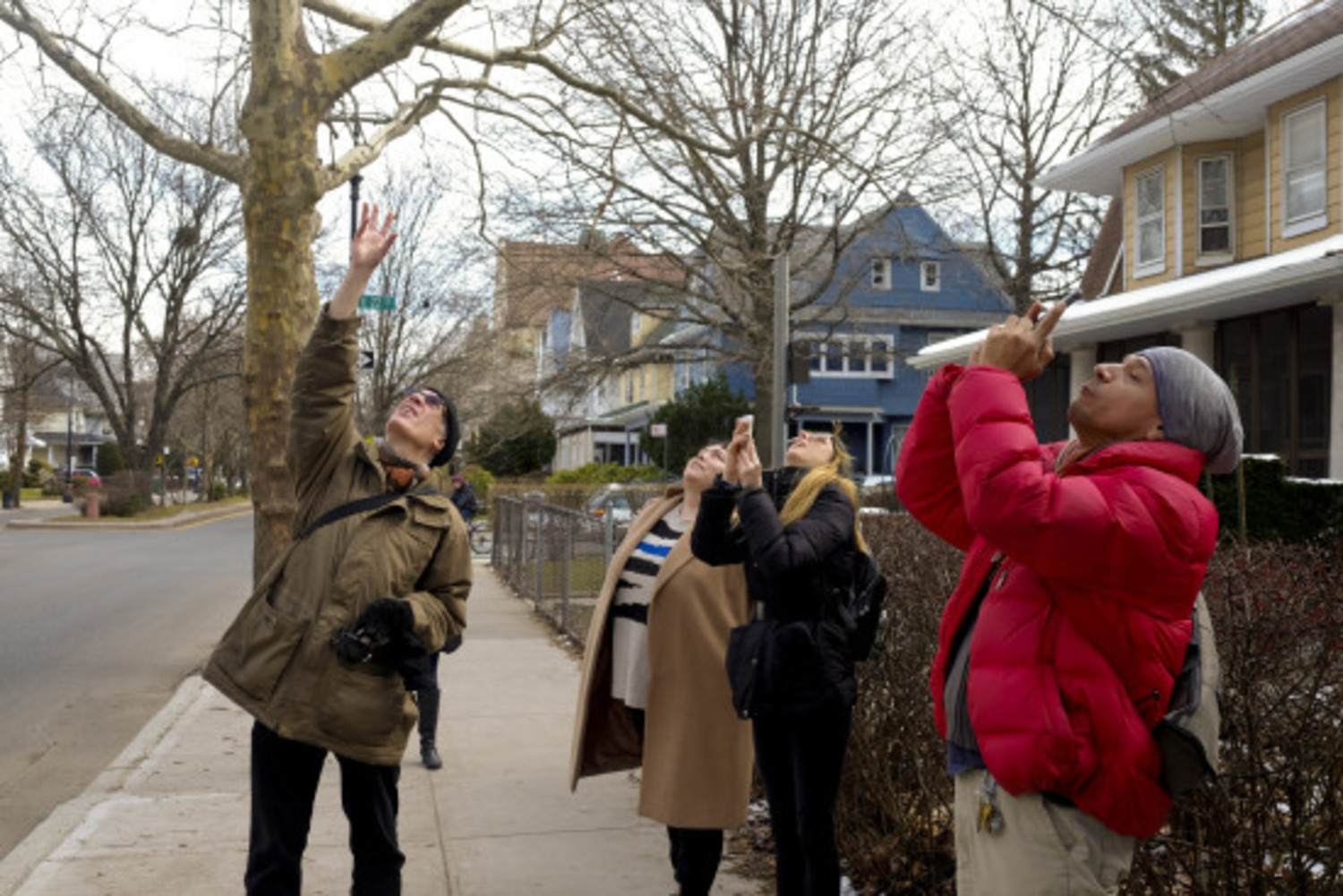 Baldwin, left, points out the location of several bird nests above on a tour March 5, 2016.
