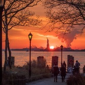 Sunset over Liberty Island from Battery Park, Manhattan