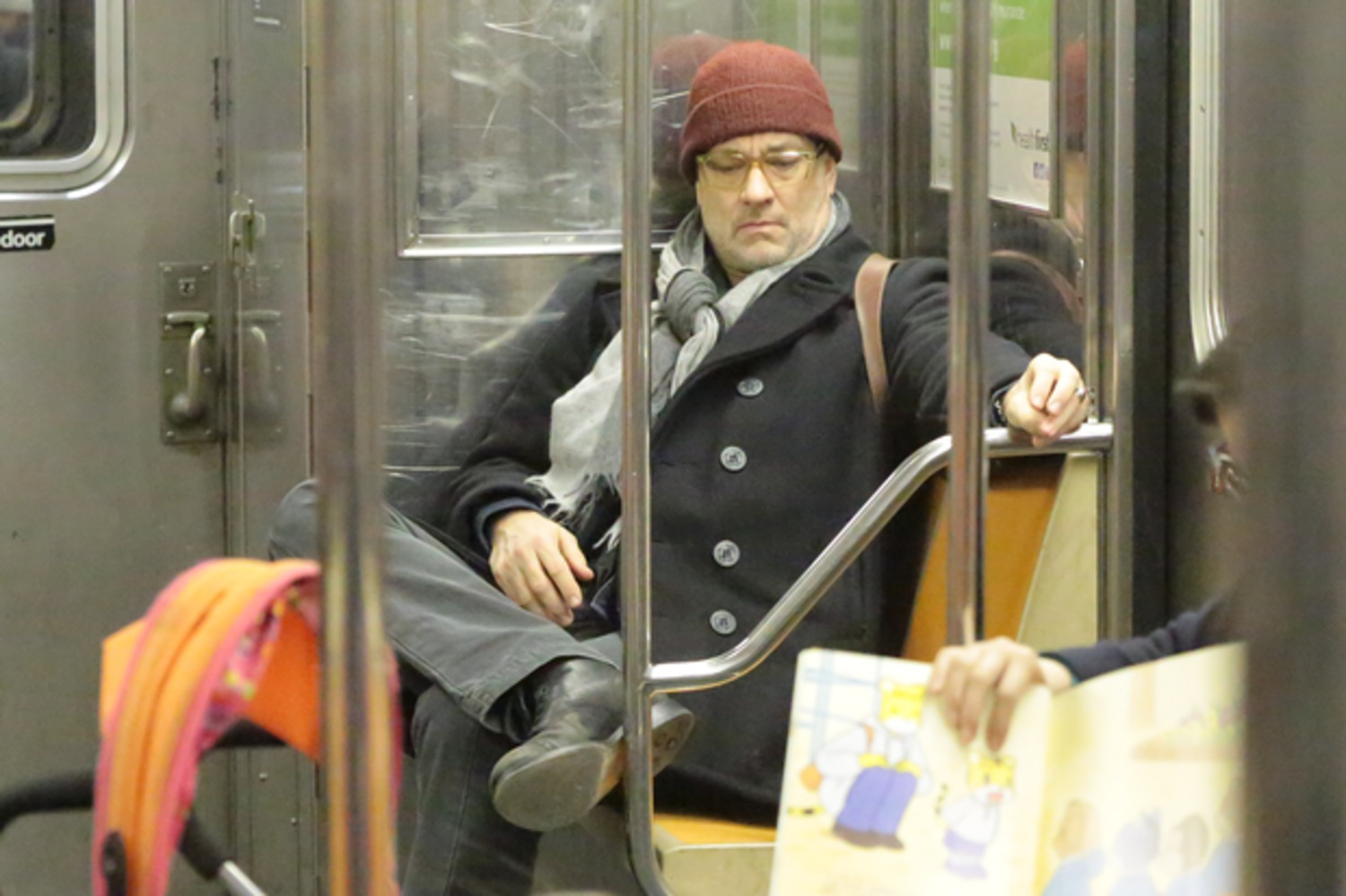 You're taking up two seats sir - Tom Hanks sits back as he rides the New York subway  http://t.co/Nq8Me2sBtJ http://t.co/gBNIBdcnAB