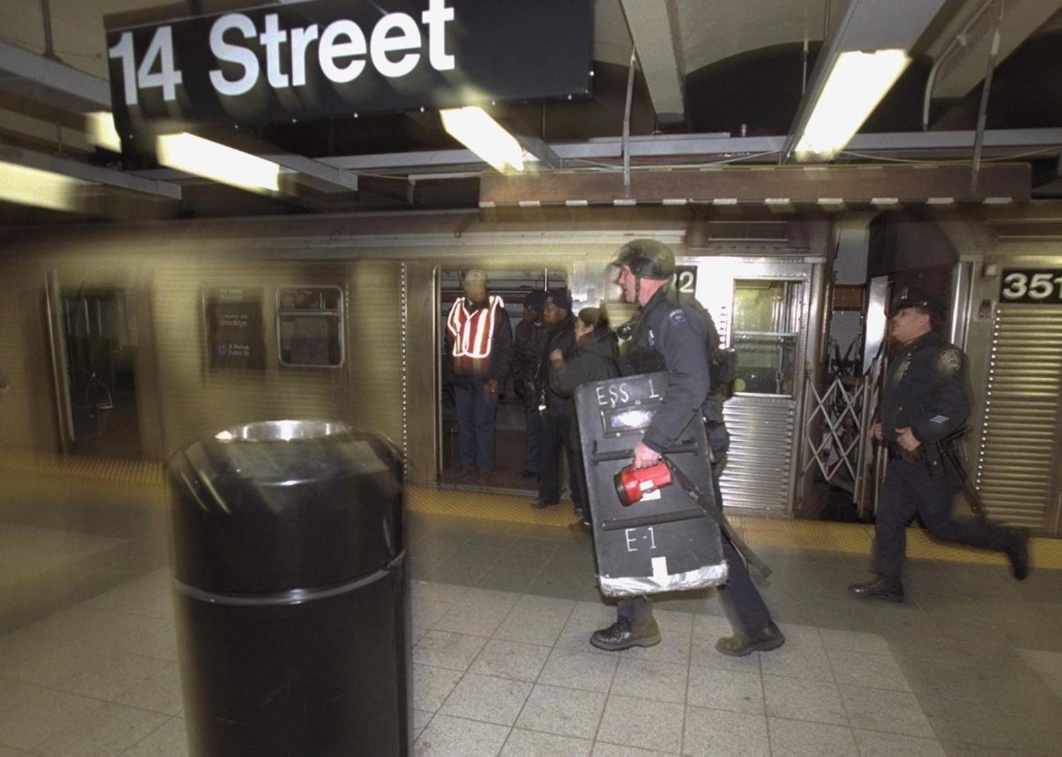 2000's: Police storm the station at 14th St. and 8th Avenue looking for a man that was shot in the leg by an off-duty NYPD officer after the suspect was seen holding a knife.