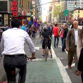 No room for Pedestrians on NYC's 8th Ave so they walk in Protected Bike Lane