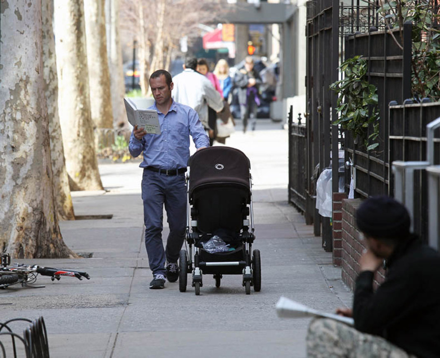 Man with stroller, 12th St., March 12, 2012.