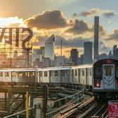 7 subway train on the elevated platform in Queens with the Manhattan skyline in the background. Queensboro Plaza Station, Queens, New York City