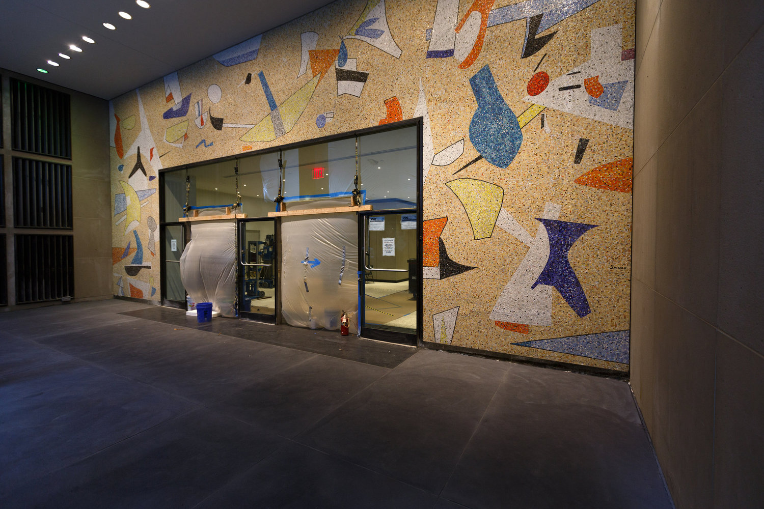 Construction workers discovered a mosaic mural by Max Spivak in the entryway to 5 Bryant Park in March. It will be preserved as part of the new lobby.