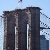 #NYCDOT raises new American flags on top of the #BrooklynBridge today, a refreshing sight after this bitter winter http://t.co/oQD4qosTAl