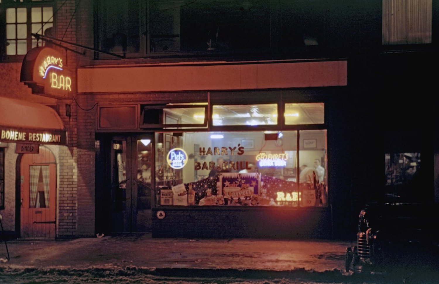 1946 Little neighborhood bar called 'Harry's Bar' lit up at night on 52nd Street around 7th Avenue Mdtown area.