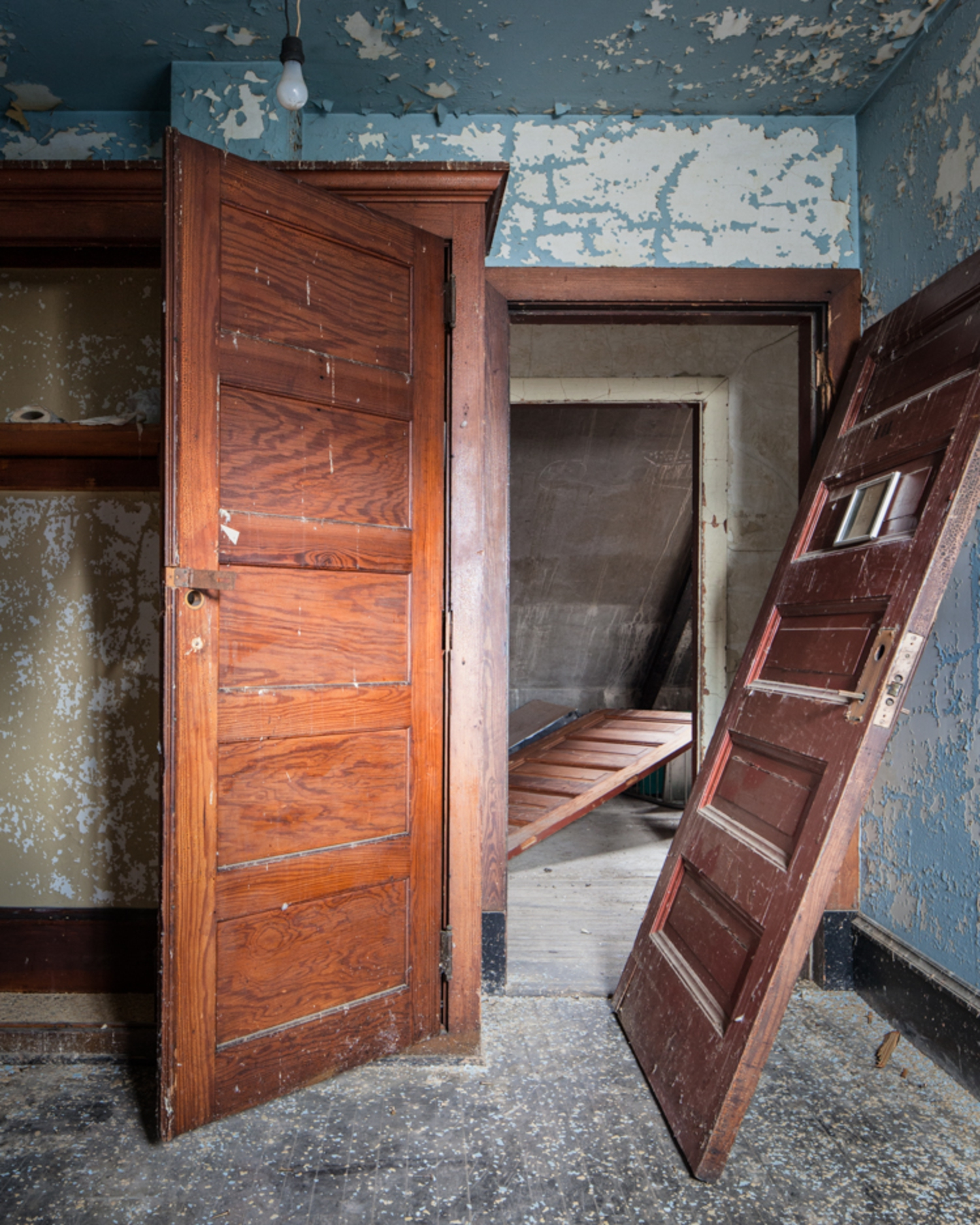 Solid wood wardrobes were far older than furniture on the lower floors.