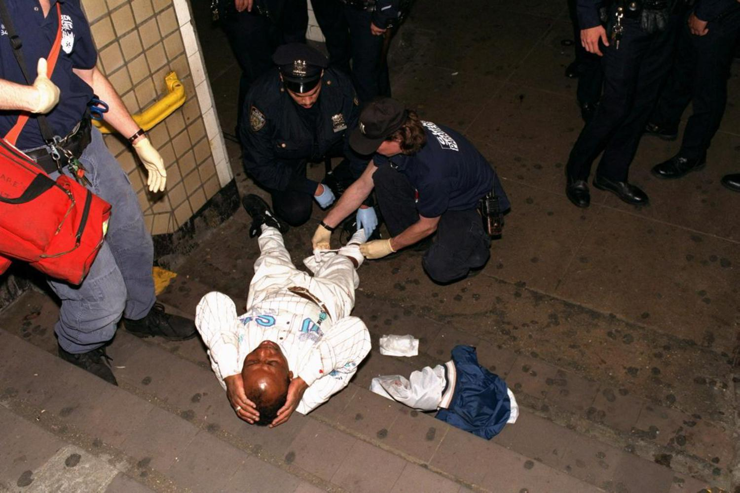 1990's: One of two shooting victims is treated by paramedics at the 34th St. and 8th Avenue subway station following a violent 1996 incident.