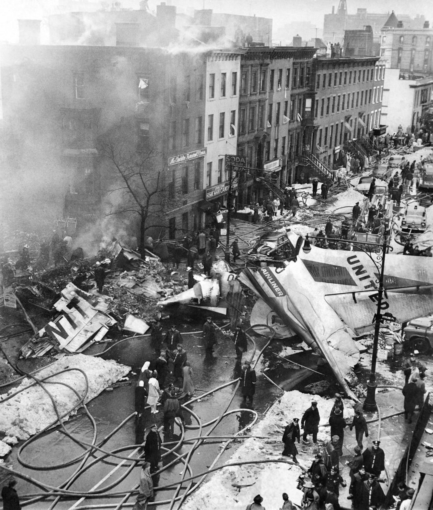 "Dec. 16, 1960: The wreckage of a jet airline fell on the ""once-fashionable Park Slope area"" at Sterling Place and Seventh Avenue, after two planes bound for New York International Airport (today's J.F.K.) and La Guardia Airport collided in midair. The second plane crashed on Staten Island; it was conjectured that the planes flew into each other there. One-hundred thirty-four people died, and the United DC-8 narrowly missed crashing into a school that was in session with ""more than 1,000 children"" in classes. It was the worst air disaster in history up to that point. The next day in Munich, there was another instance of a plane crashing into a busy metro area, with 52 people, including 19 Americans, killed."