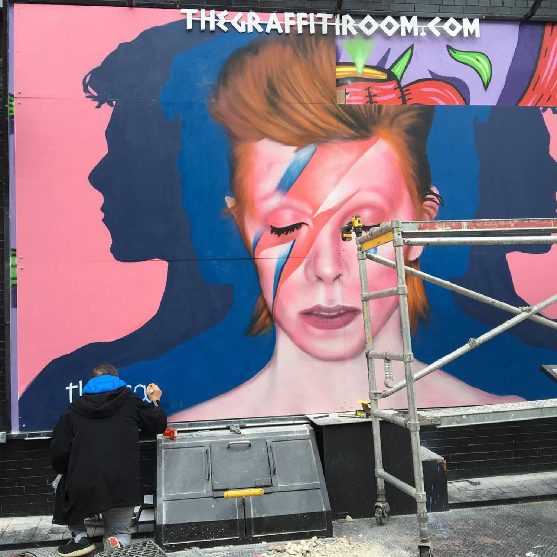 Artist painting his signature. #ripdavidbowie #nyc #newyorkcity #soho