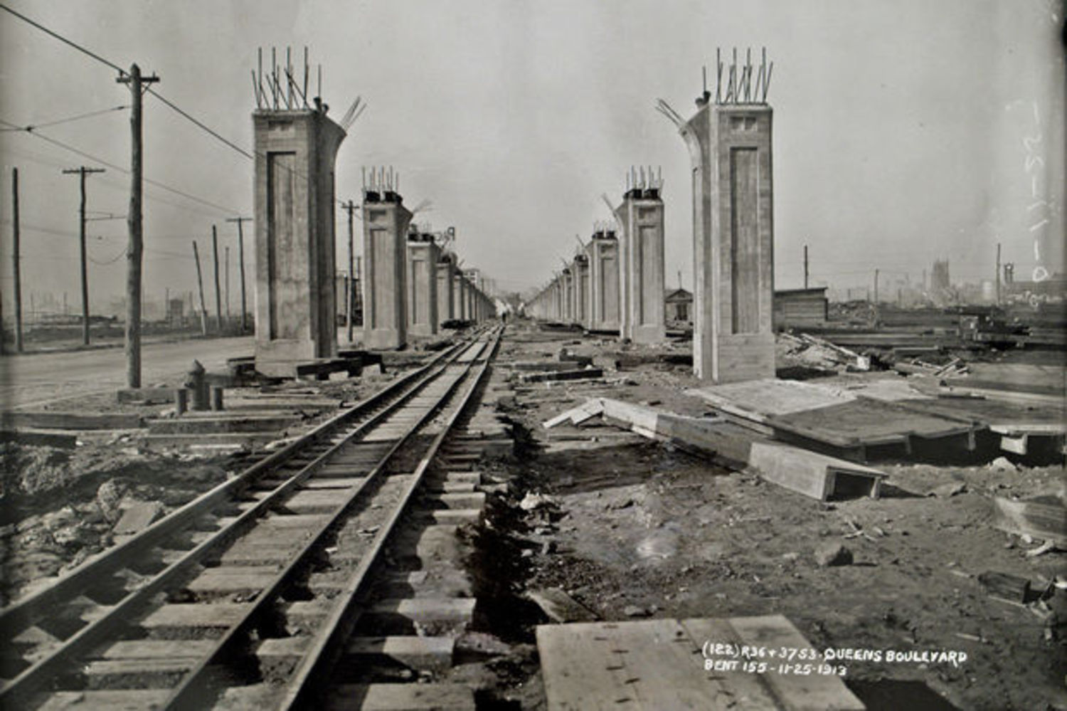 A shot of the Queens Boulevard elevated line under construction in 1913 in the area between what is now Long Island City and Sunnyside.