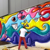 The Legendary Kenny Scharf Graces Massive Central Bronx Wall With His Buoyant, Magical Characters