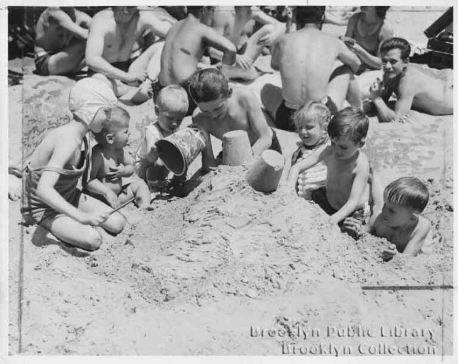 Sand castles: As popular in 1946 as they are in 2015.
