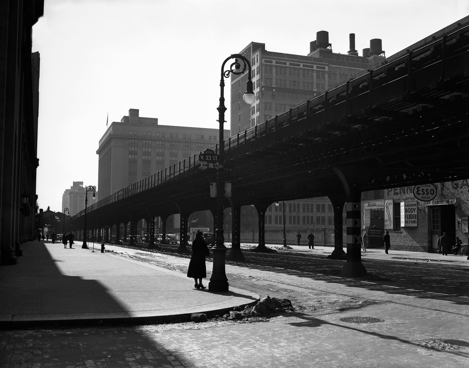 "The Ninth Avenue ""El"", or elevated, tracks are seen looking south at 33rd Street in New York, Feb. 22, 1940. The transit commission authorized condemnation of the structure."