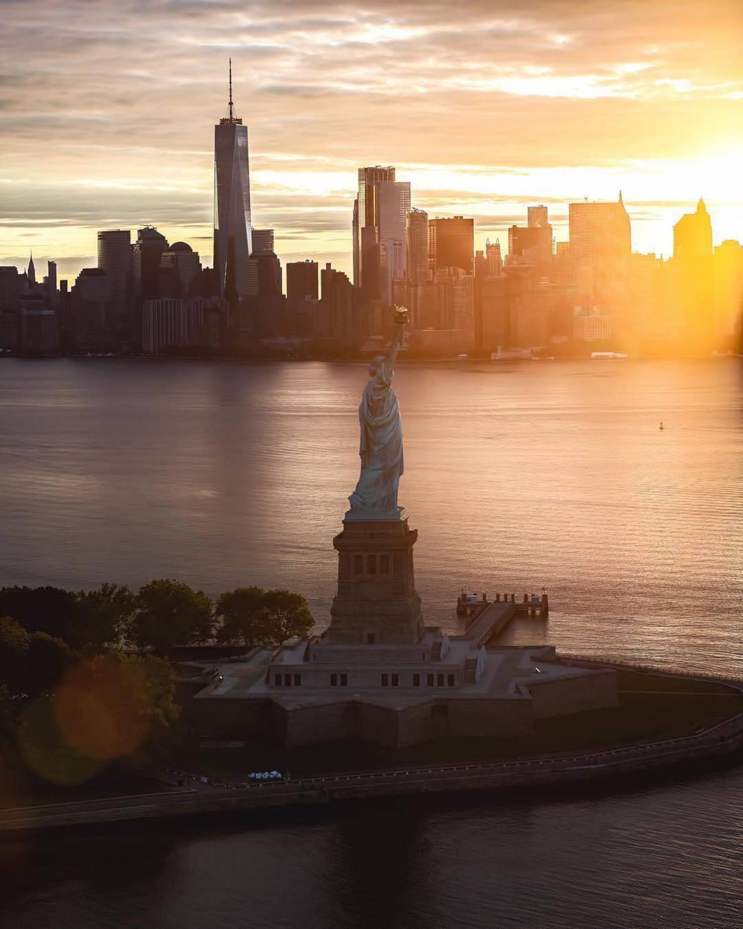New York, New York. Photo via @flynyon #viewingnyc #newyork #newyorkcity #nyc #sunrise #statueofliberty