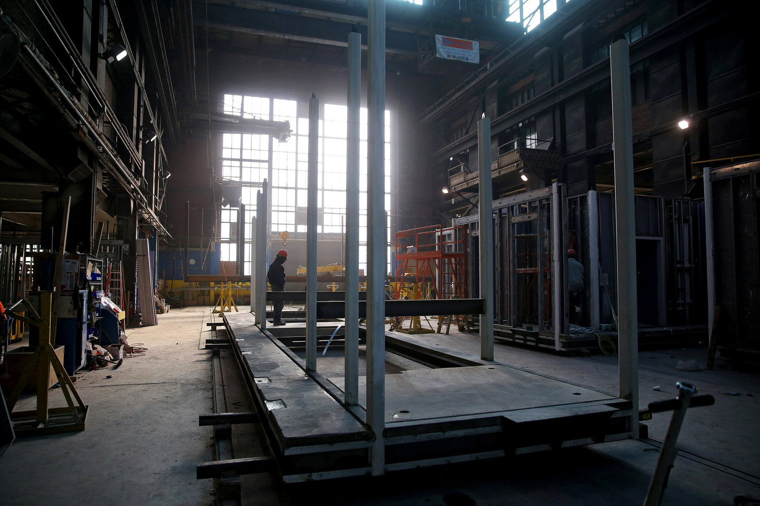 The elevator shaft, stairwell shaft, and stairwell landings are all located within one module per floor.