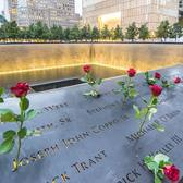 """Remembering 9/11. """"Reflecting absence"""" in the twin waterfalls and pool set within the original footprints of the World Trade Center's twin towers. Lower Manhattan, New York City."""