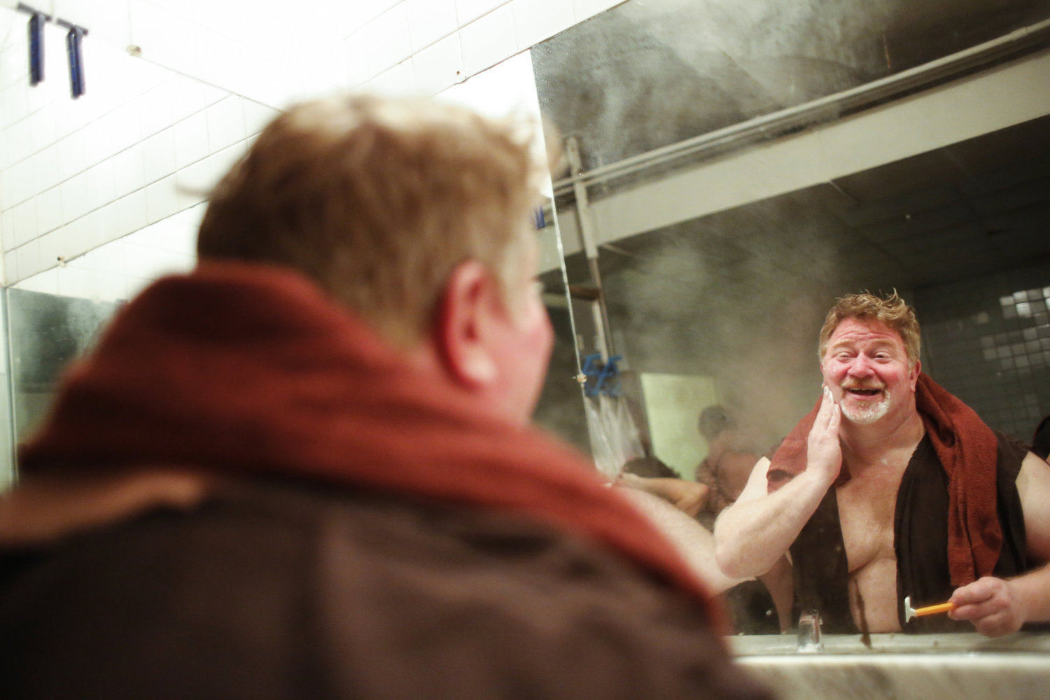 Rich Trince shaves at the bathhouse on a Boris week. Mr. Trince, 50, has been visiting the baths for 20 years.
