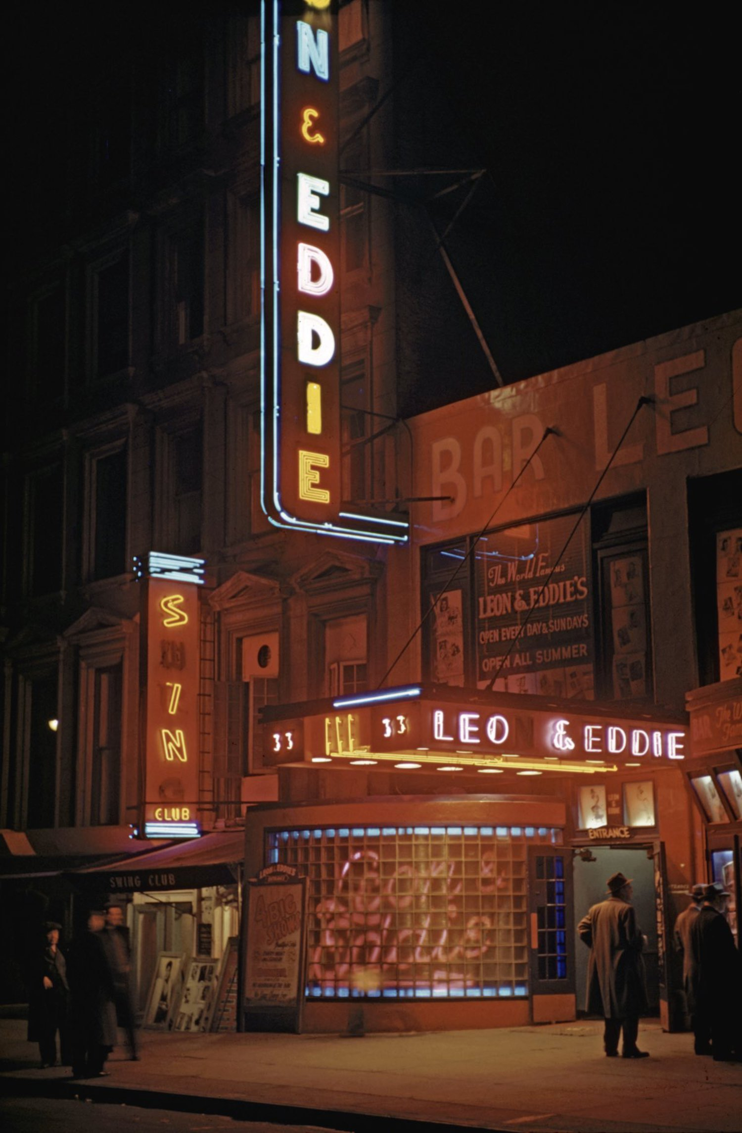 1946 Leon and Eddie's nightclub on 52nd street in Times Square (midtown) at night with patrons hanging out on the sidewalk.