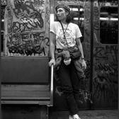 1980's: Lisa Sliwa, a member of the Guardian Angels and wife of its founder, Curtis Sliwa, patrols the subway dressed in her uniform with its signature red beret.