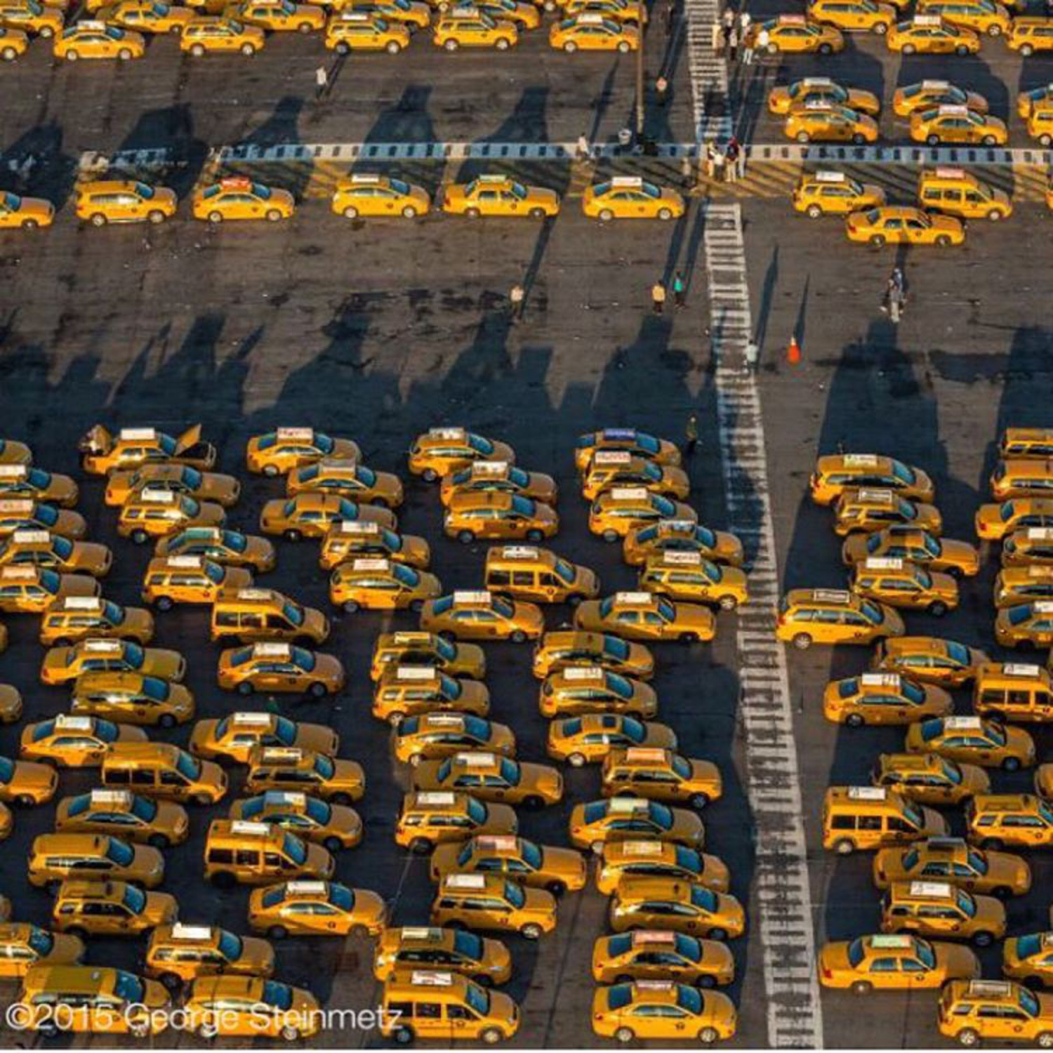 Photograph by George Steinmetz @geosteinmetz / @thephotosociety  It's a long wait for a good fare at JFK's Central Taxi Hold lot.  According to the 2014 Taxi Factbook, people traveling to and from the city's airports represent 5% of all taxi trips, and about 10% of all passengers arriving at and departing from #JFK use a taxi.