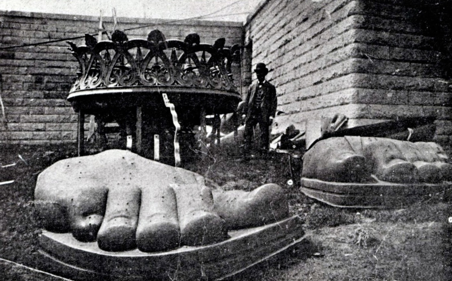 The feet of the Statue of Liberty arrive on Liberty Island in 1885.