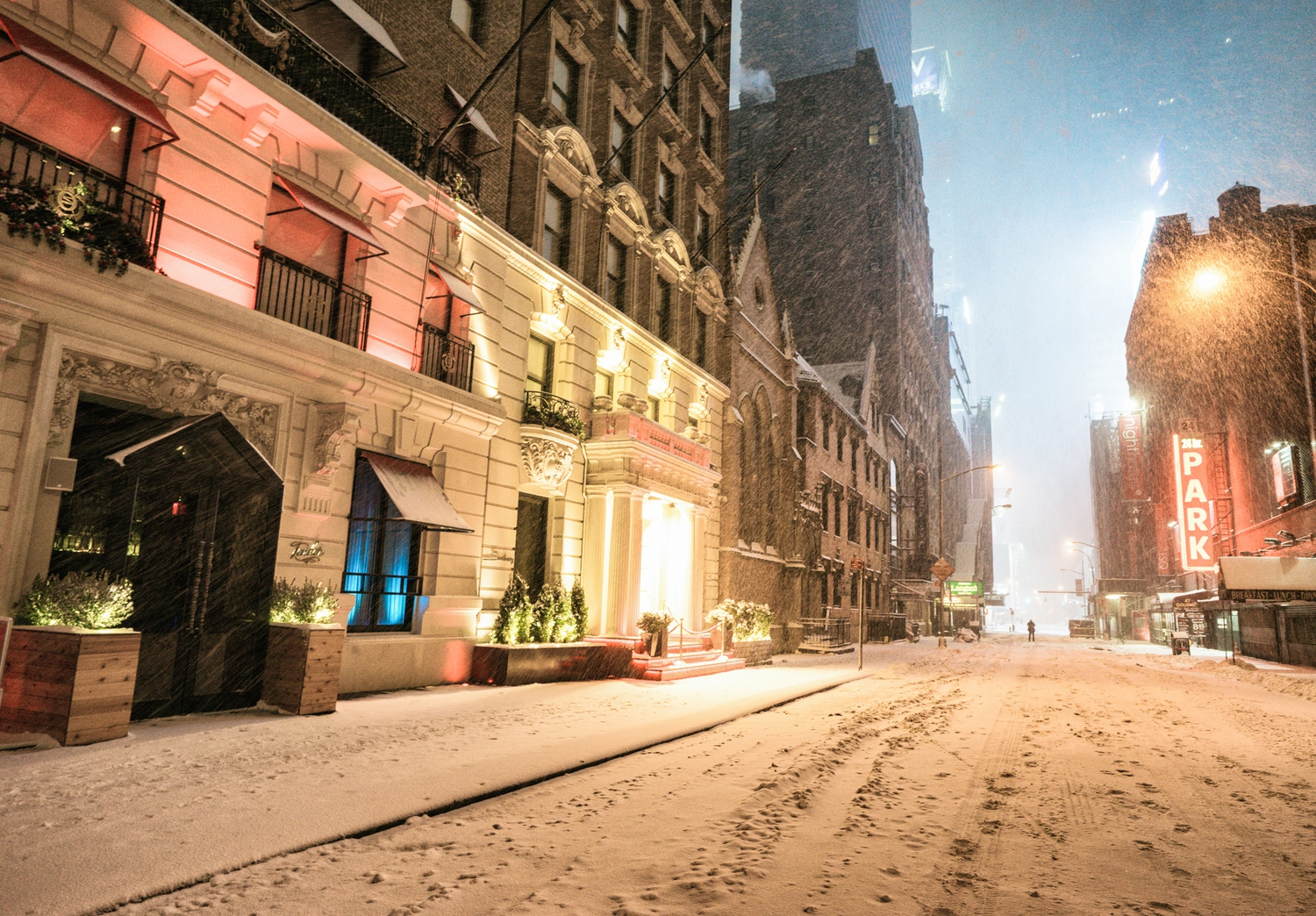 "New York City - Snow - Winter Storm Juno - Near Times Square | Juno: The first snowstorm of 2015 in New York City.  ---  (Note: My <a href=""http://www.amazon.com/gp/product/1440339589/ref=as_li_tl?ie=UTF8&camp=1789&creative=9325&creativeASIN=1440339589&linkCode=as2&tag=nyththle0e-20&linkId=ER6GYT5FRYNMEPLF"" rel=""nofollow"">New York photography book</a> released worldwide in stores/online recently and has photos similar to this  [full info below])  ---  I have been photographing New York City during snowstorms at night for the past 5 years. When it comes to experiencing <a href=""http://nythroughthelens.com/tagged/snow"" rel=""nofollow"">New York City in the snow</a>, I relish the challenge. The more gusty, snowy, and brutal the storm, the more of a chance that I will be out in it traipsing around New York City with my cameras in tow.  When I heard that the MTA was suspending all transit service (and most vehicles) at 11 pm, I made the decision to take the train up to the Upper East Side prior to 11 pm to deposit myself up there with the intention of walking from the Upper East Side to Times Square and then walking the several miles back to the Lower East Side (whew!!).  The streets were eerily empty.  Emptier than they are usually at night during snowfall. Since there was a ban on all vehicles aside from snow plows and emergency services, there were practically no cars at all on the streets. Even taxis were banned from the streets!  I walked in the middle of avenues and streets that are usually teeming with cars.  There was an eerie sense of calm.  It was magical.   ---  This is part of a post that I posted to my NYC photography blog. If you are curious enough to look at the photos there, here is the link to the post:  <a href=""http://nythroughthelens.com/post/109291619025/new-york-city-snow-winter-storm-juno-i"" rel=""nofollow"">New York City - Winter Storm Juno</a>   ----  * As mentioned above - My New York City coffee table book that released in stores/online worldwide recently.   Tons of information about my <a href=""http://www.amazon.com/gp/product/1440339589/ref=as_li_tl?ie=UTF8&camp=1789&creative=9325&creativeASIN=1440339589&linkCode=as2&tag=nyththle0e-20&linkId=ER6GYT5FRYNMEPLF"" rel=""nofollow"">New York photography book</a> with sample pages (including where to order and what stores are carrying it) here:  <a href=""http://nythroughthelens.com/post/92873566010/ny-through-the-lens-the-book-i-am-super"" rel=""nofollow"">NY Through The Lens: A New York Coffee Table Book</a> ---   View my New York City photography at my website <a href=""http://nythroughthelens.com/"" rel=""nofollow"">NY Through The Lens</a>.  View my Travel photography at my travel blog: <a href=""http://travelinglens.me/"" rel=""nofollow"">Traveling Lens</a>.  Interested in my work and have questions about PR and media? Check out my:  <a href=""http://nythroughthelens.com/about"" rel=""nofollow"">About Page</a> 