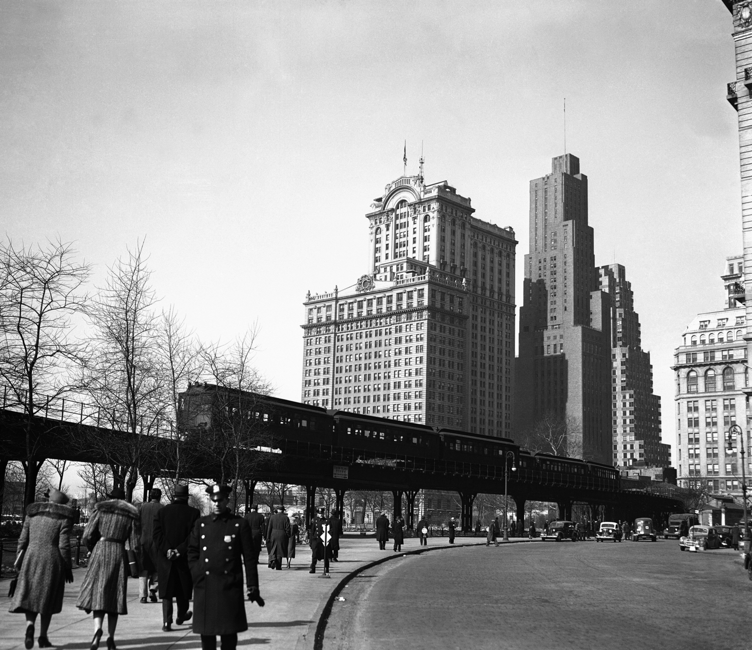 "The Ninth Avenue ""El"" or elevated, is shown looking north along State Street in New York, Feb. 22, 1940. The transit commission has authorized the condemnation of the structure."