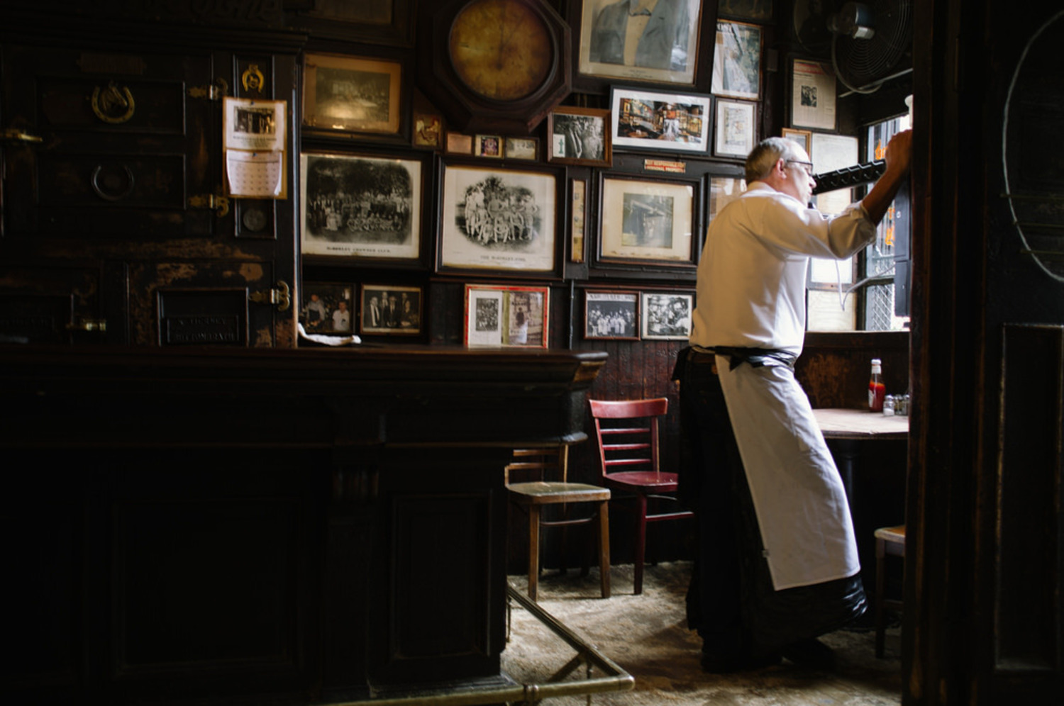 Bartender gazes out the window at McSorley's Old Ale House