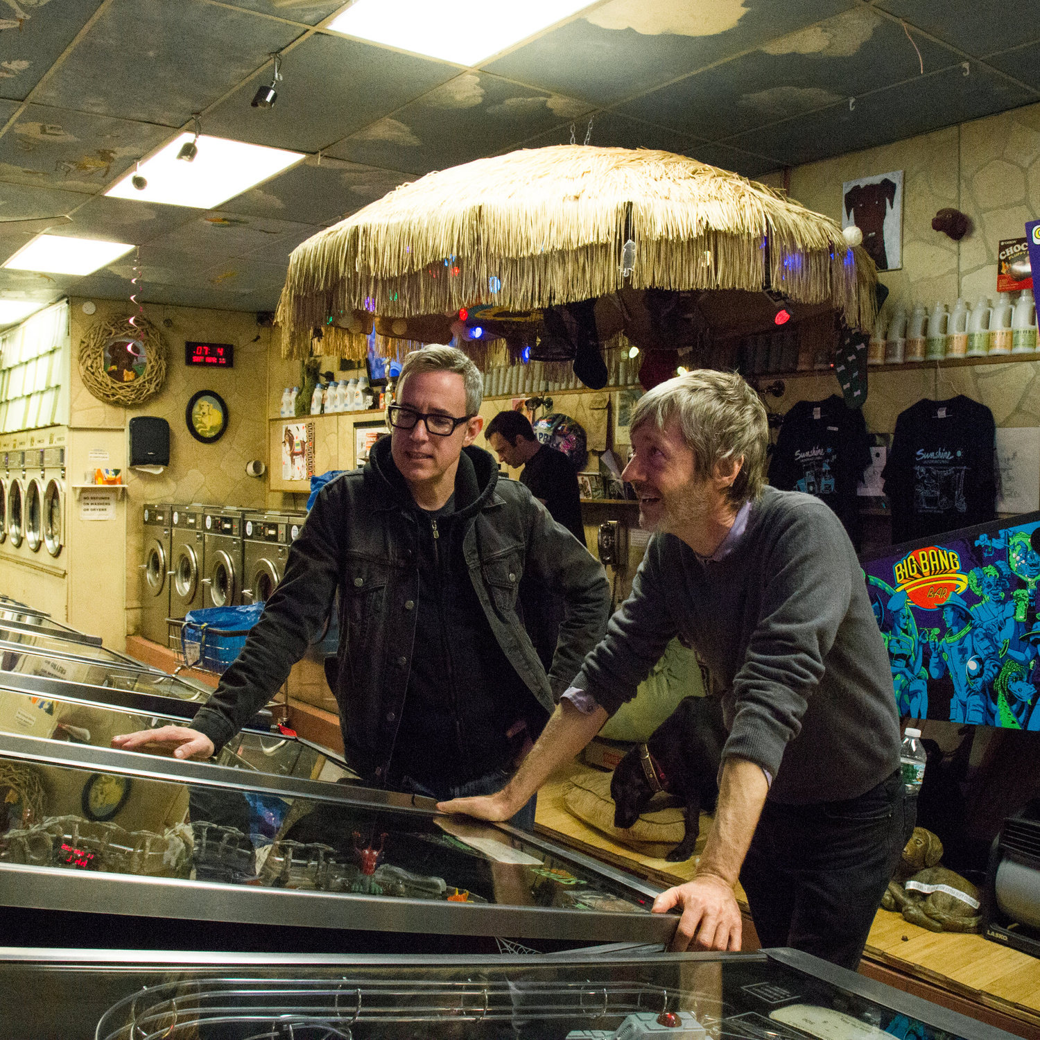 Patrick Ryan and Fred Blair came to the Sunshine Laundromat to play pinball. Located in the Greenpoint section of Brooklyn, the laundromat was recently remodeled to include a 1,000-square-foot arcade with 23 pinball machines, a photo booth and a fortune-telling machine, along with a bar that serves wine and beer.