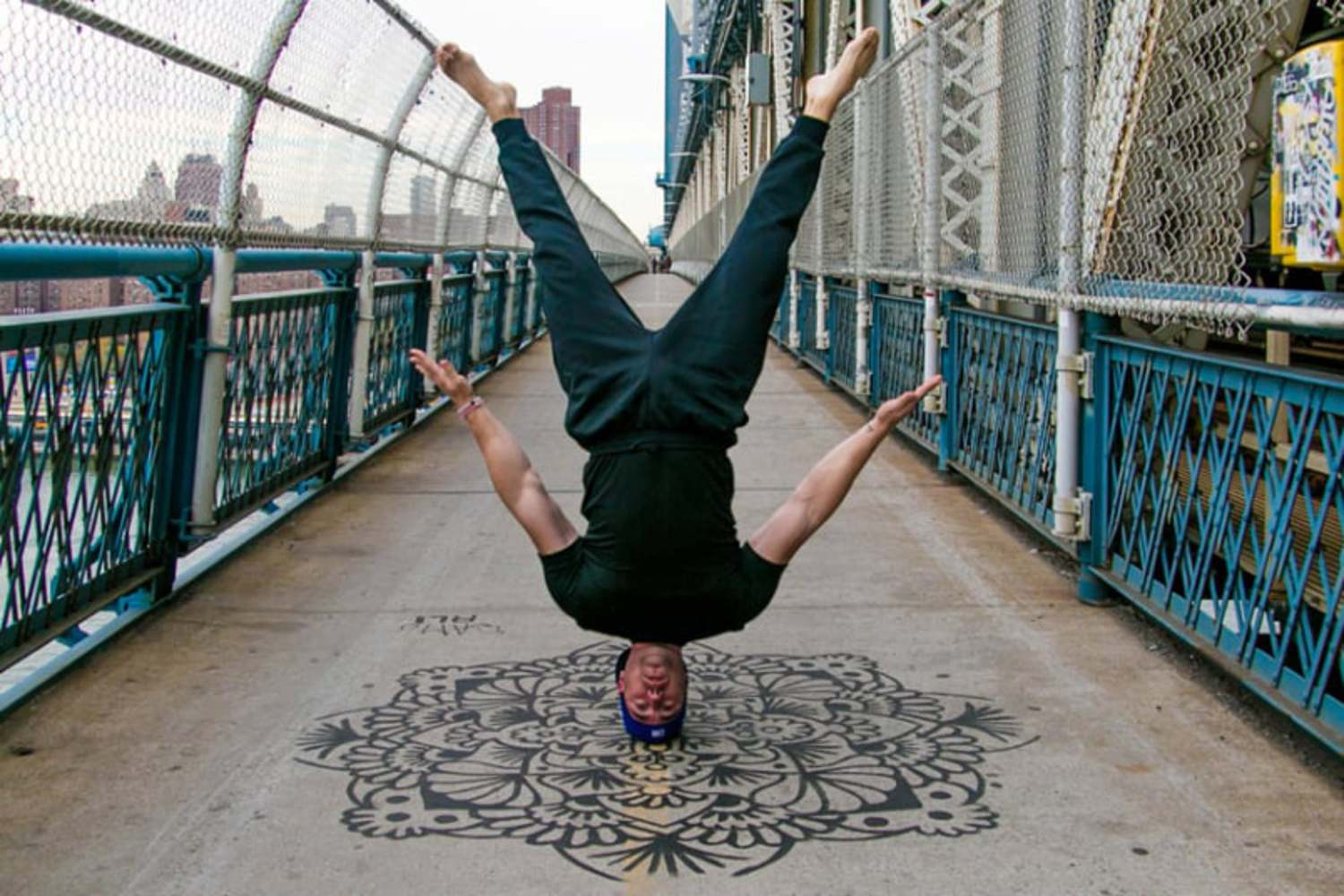 A yoga headstand on the Manhattan Bridge