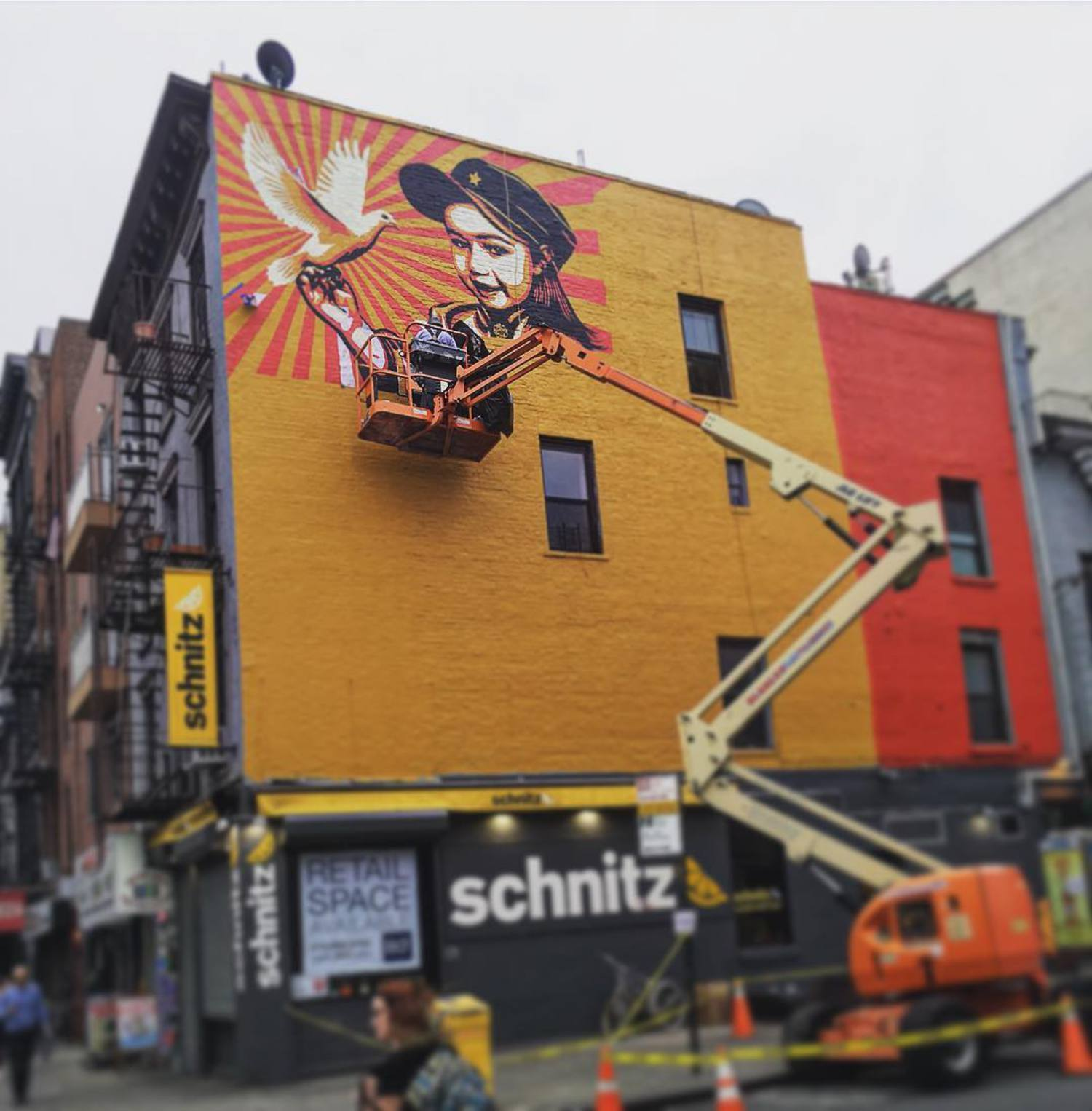 Shepard Fairey at work this evening on 11th Street at 1st Avenue #eastvillage #mural #streetart #shepardfairey #lisaproject #obeygiant #publicart In collaboration with @thelisaprojectnyc