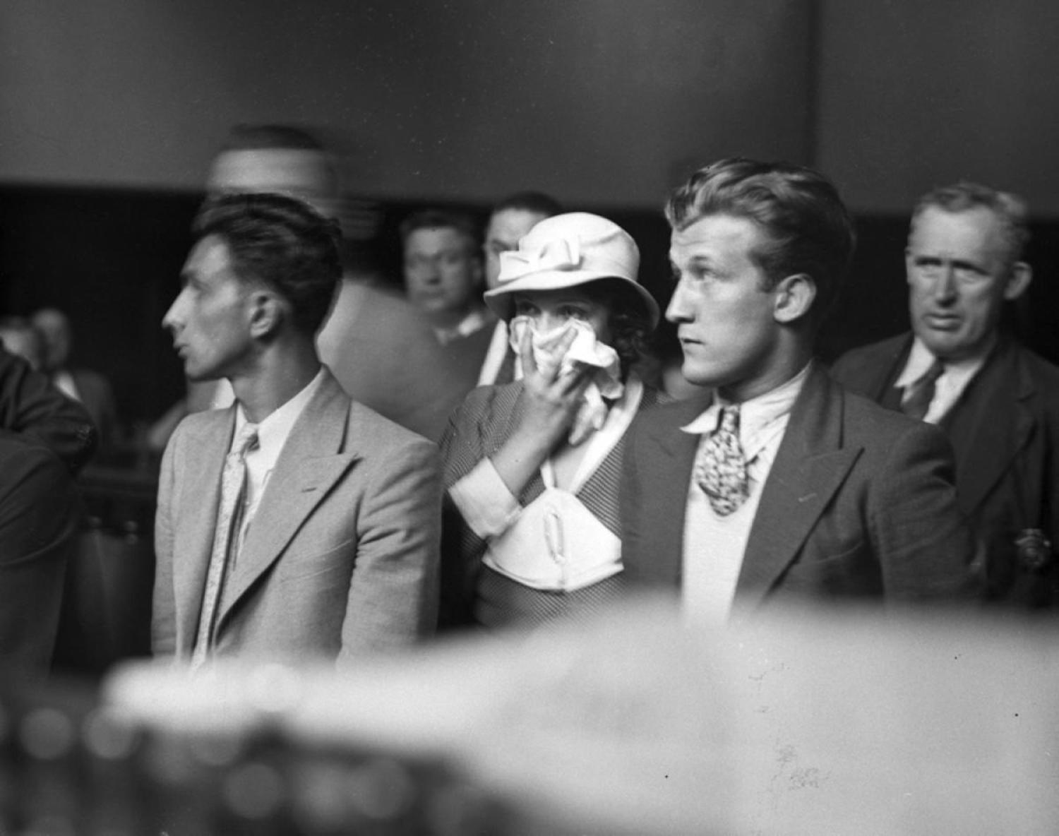 Mob Moll, 1933: Being married to a hitman will almost always get you into trouble, and no one knew that better than Lottie Coll, wife of Irish mobster Vincent 'Mad Dog' Coll. Here, Coll holds her scarf to her face as she is arraigned in court in 1933.